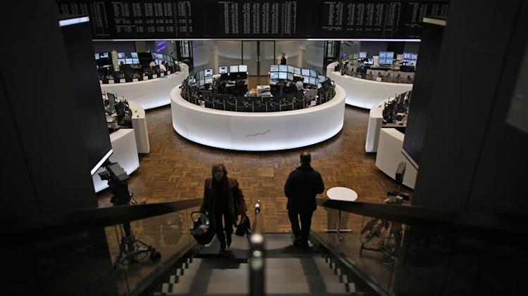 People make their way at the German stock exchange in Frankfurt
