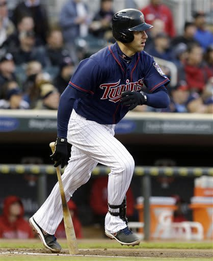 Mauer's 4 hits lift Twins over Angels