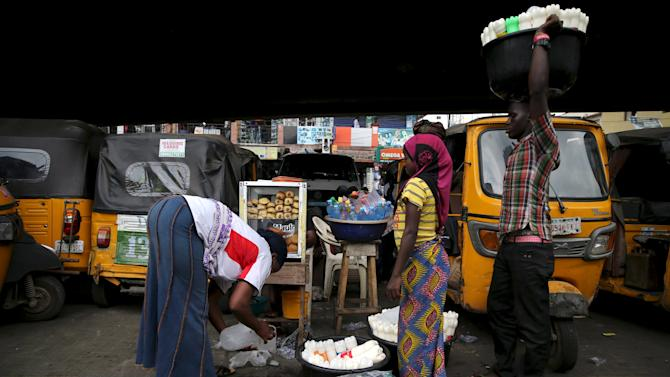 File photo of vendors selling their wares under a bridge where commercial tricycles are parked in Obalende district in Nigeria's commercial capital Lagos