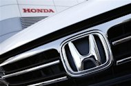 A Honda Odyssey car is displayed outside Honda Motor Co's showroom in Tokyo January 31, 2013. REUTERS/Issei Kato
