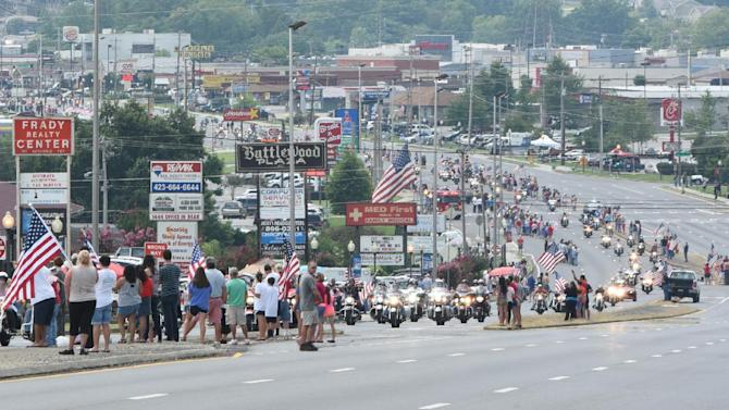 Patriot Guard motorcycles participate in the funeral procession for Navy Petty Officer 2nd Class Randall Smith in Fort Oglethorpe on Tuesday, July 28, 2015.  Scott was one of five servicemen whose death was the result of a series of shootings at military facilities in Chattanooga, Tennessee, on July 16, 2015. (Tim Barber/Chattanooga Times Free Press via AP) MANDATORY CREDIT: TIM BARBER/CHATTANOOGA TIMES FREE PRESS NOOGA.COM, CLEVELAND DAILY BANNER & DALTON DAILY CITIZEN OUT