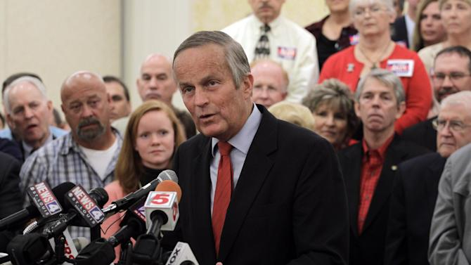 Missouri Republican Senate candidate, Rep. Todd Akin, R-Mo., speaks while surrounded by supporters during a news conference at the start of a statewide bus tour, Tuesday, Sept. 25, 2012, in St. Louis. Akin is hoping that donors displeased by his much-criticized remarks about rape will reopen their checkbooks. (AP Photo/Jeff Roberson)