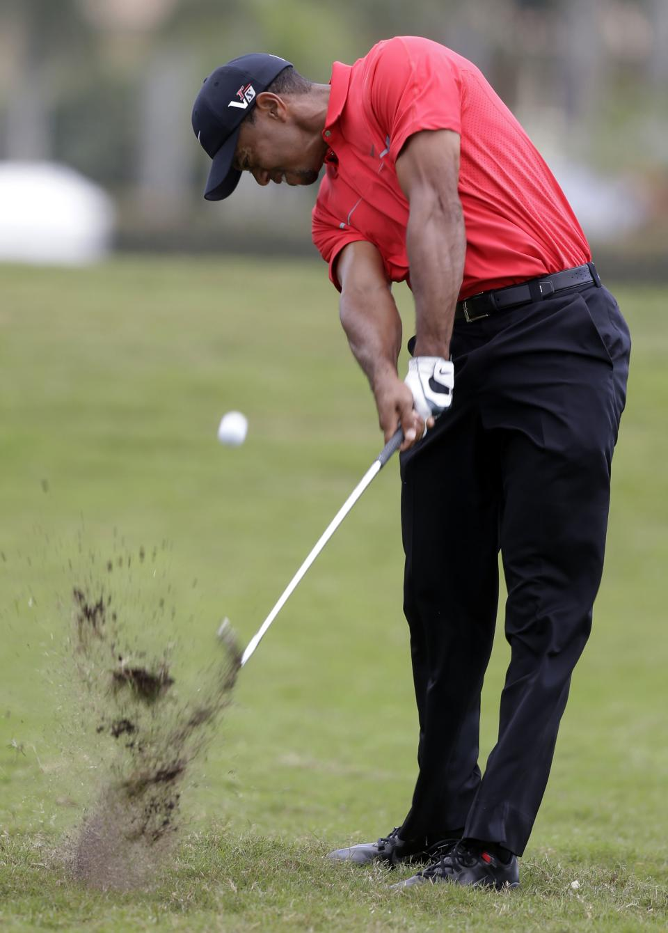 Tiger Woods hits from the second hole fairway during the third round of the Cadillac Championship golf tournament on Sunday, March 10, 2013, in Doral, Fla. (AP Photo/Wilfredo Lee)
