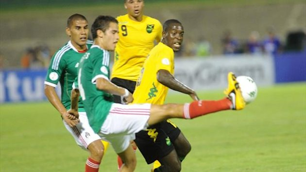 Mexican Diego Reyes and Je-Vaughn Watson of Jamaica during the CONCACAF World Cup qualifier at the National Stadium in Kingston (AFP)