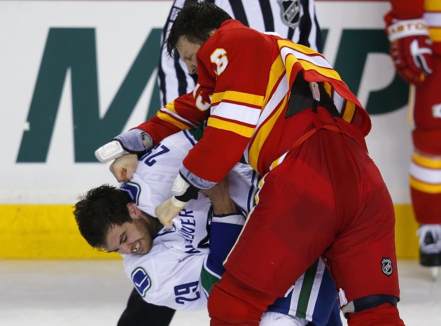 Calgary Flames' McGrattan punches Vancouver Canucks' Sestito during a fight in the second period of their NHL hockey game in Calgary, Alberta