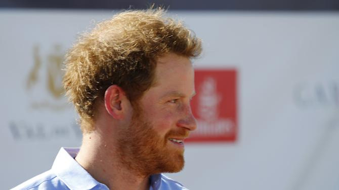 Britain's Prince Harry arrives for the Sentebale Royal Salute Polo Cup