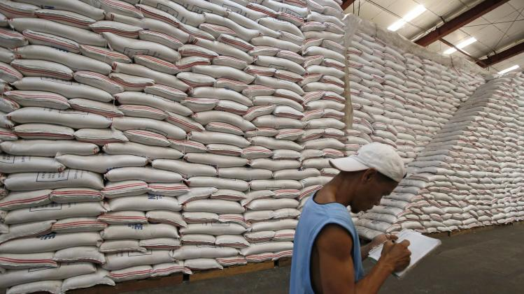 A NFA worker makes an inventory of rice stocks at a government rice warehouse in Taguig, Metro Manila