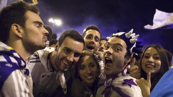 Real Madrid fans celebrate after their team won the Champions League final soccer match, taking place in Portugal, in Madrid, Spain, Saturday, May 24, 2014. (AP Photo/Gabriel Pecot)