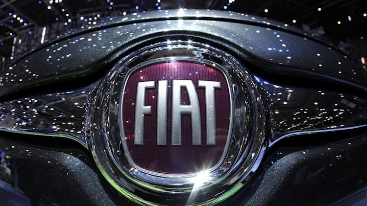 File photo shows the Fiat logo in a car displayed on the Fiat booth during the first media day of the Geneva Auto Show at the Palexpo in Geneva