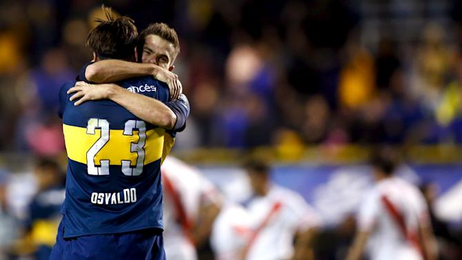 Boca Juniors' Osvaldo and Gago embrace as they celebrate after winning their Argentine First Division soccer match against River Plate in Buenos Aires