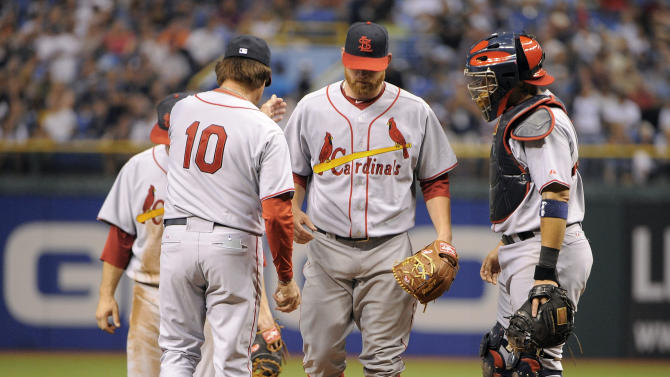 St. Louis Cardinals catcher Yadier Molina, right, wacthes manager Tony La Russa (10) take pitcher Kyle McClellan, center, off the mound after he allowed the Tampa Bay Rays five runs during the sixth inning of a baseball game, Saturday, July 2, 2011, in St. Petersburg, Fla. (AP Photo/Brian Blanco)