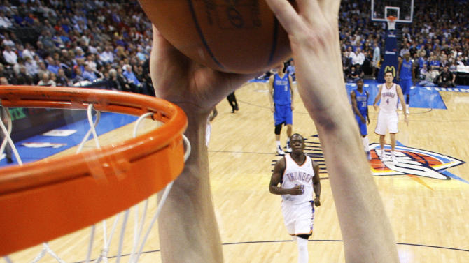 Dallas Mavericks forward Dirk Nowitzki (41), of Germany, dunks in front of Oklahoma City Thunder forward Kevin Durant (35) in the second quarter of an NBA basketball game in Oklahoma City, Monday, March 5, 2012. (AP Photo/Sue Ogrocki)