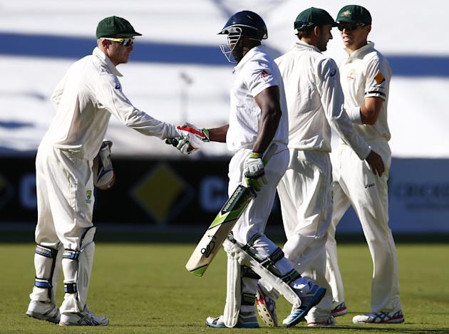 Australia's Haddin shakes hands with England's Carberry as they walk off field at end of second day's play in second Ashes cricket test at Adelaide Oval