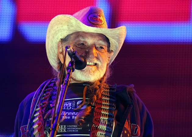 "FILE - This Sept. 22, 2012, file photo shows country music legend Willie Nelson performing during the Farm Aid 2012 concert at Hersheypark Stadium in Hershey, Pa. Nelson will release ""Roll Me Up And Smoke Me When I Die"" on Nov. 13. Publisher William Morrow says the American music icon will tell never-before-heard stories about his life, family, music, politics, Texas, religion and favorite recreational activity. (AP Photo/Jacqueline Larma, File)"