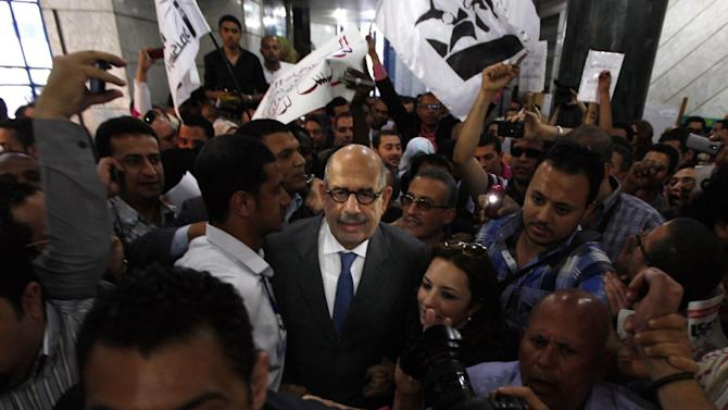 The Nobel Peace laureate Mohamed El Baradei, center, surrounded by his supporters upon his arrival to the journalists syndicate for holding a presser to launch his new Constitution political party in Cairo, Egypt, Saturday, April 28, 2012. Reform leader Mohammed ElBaradei has returned to Egypt's public political life to launch a new political party which he says aims to unite Egyptians, and salvage the revolution from a messy democratic transition. (AP Photo/Khalil Hamra)