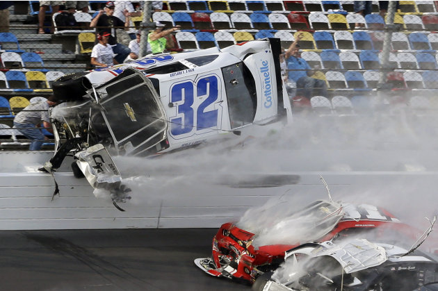 Kyle Larson (32) goes airborne and into the catch fence during a multi-car crash involving Justin Allgaier (31), Brian Scott (2) and others during the final lap of the NASCAR Nationwide Series auto ra