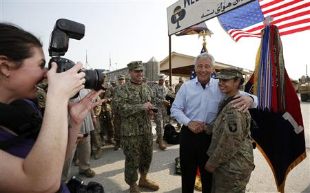 U.S. Secretary of Defense Chuck Hagel poses for a picture with a member of the U.S. 101st Airborne Division during his visit to Jalalabad Airfield in eastern Afghanistan, March 9, 2013. REUTERS/Jason Reed