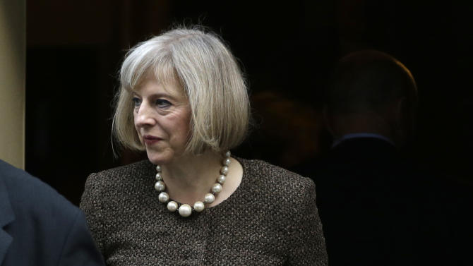 Britain's Home Secretary Theresa May leaves 10 Downing Street in London, Tuesday, Oct. 16, 2012, following a cabinet meeting. Britain's Home Secretary is set to rule on whether to extradite a British hacker to America later today, to face charges for breaking into sensitive computer networks at U.S. military and space installations. (AP Photo/Alastair Grant)
