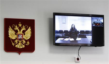 Jailed Pussy Riot punk rock group member Maria Alyokhina is seen on a monitor, as she takes part in a video conference from the penal colony, inside the courtroom during a hearing in the town of Berezniki May 22, 2013. REUTERS/Maxim Shemetov