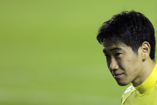 Japan's Shinji looks on during a soccer training session ahead of the Confederations Cup in Brasilia