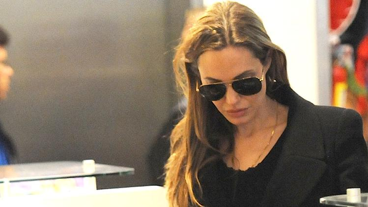 Angelina Jolie, Pax and Knox go shopping at F.A.O Schwarz in NYC