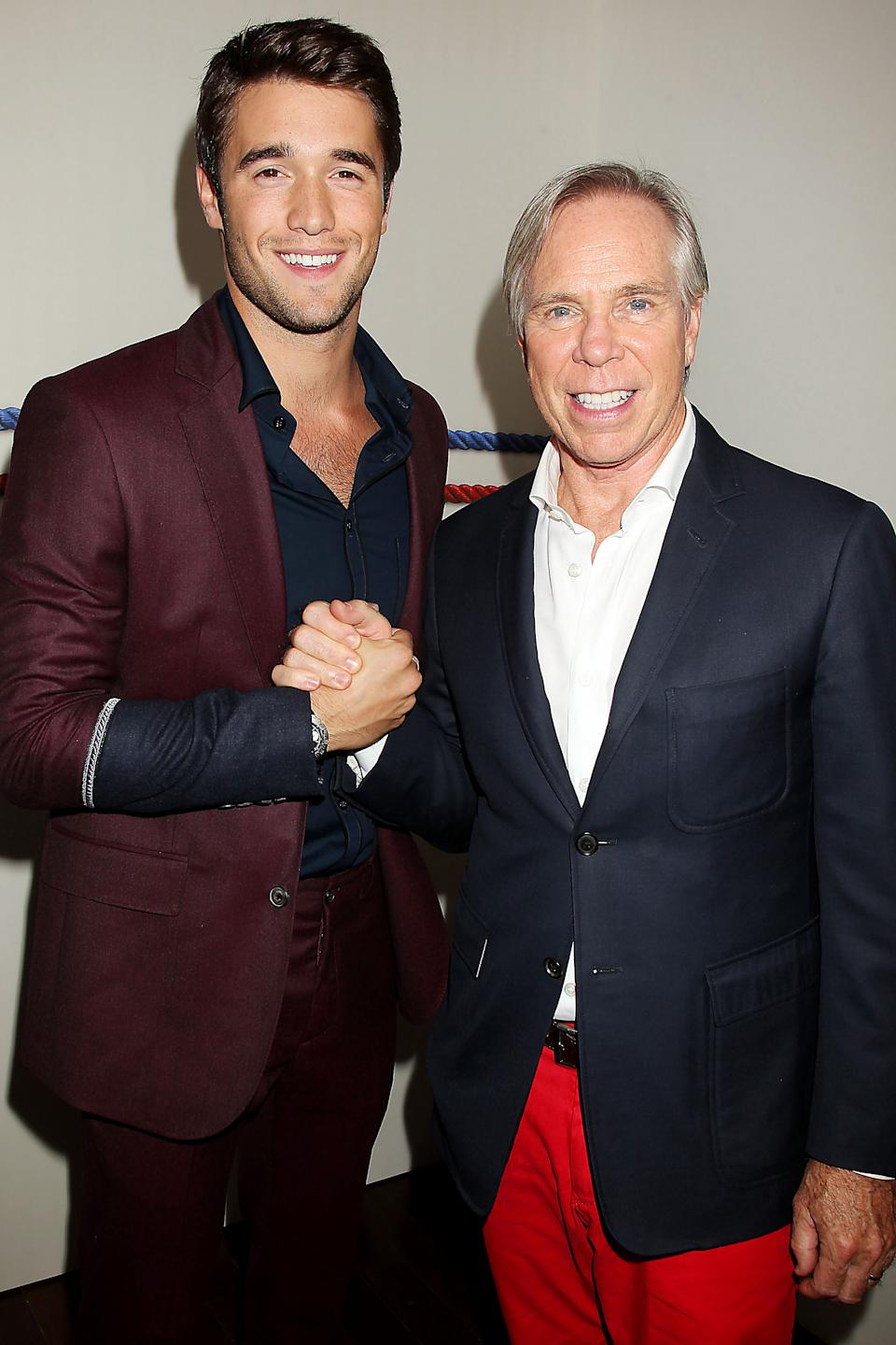 "This image released by Starpix shows actor Josh Bowman from the TV series ""Revenge,"" left, and designer Tommy Hilfiger at the presentation for the 2013 Tommy Hilfiger Mens Collection Friday, Sept. 7, 2012 during Fashion Week in New York. (AP Photo/Starpix, Dave Allocca)"