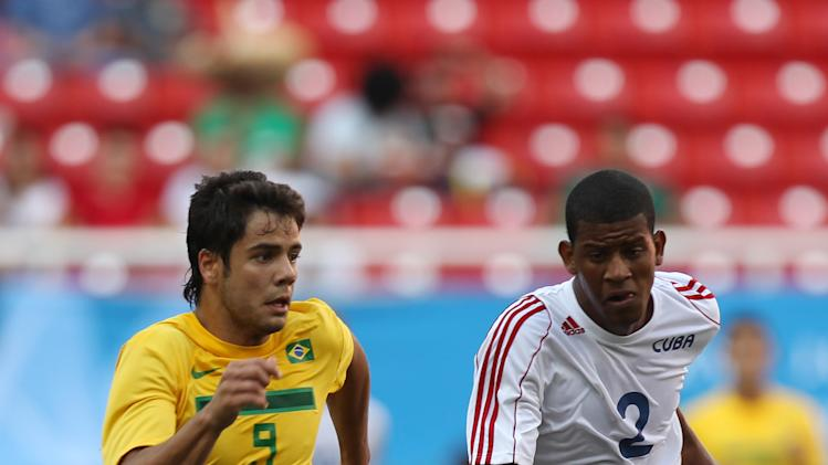 Brazil's Henrique Nascentes, left, fights for the ball with Cuba's Dayan Hernandez during a men's soccer match at the Pan American Games in Guadalajara, Mexico, Friday, Oct. 21, 2011. (AP Photo/Juan Karita)