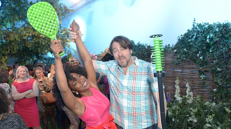 IMAGE DISTRIBUTED FOR PIMM'S - Jonathan Ross, right, and Cleo Higgs seen at the Pimm's Summer Garden in London on Tuesday, June 18, 2013. (Photo by Jon Furniss/Invision for Pimm's/AP Images)
