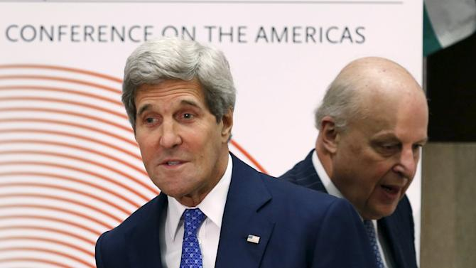 United States Secretary of State Kerry is accompanied by John Negroponte before remarks at 45th annual Washington Conference on the Americas in Washington