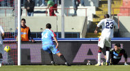 Cagliari forward Victor Ibarbo, of Colombia, right, scores during Serie A soccer match between Catania and Cagliari in Catania, Italy, Sunday, Dec. 4, 2011. (AP Photo/Carmelo Imbesi)