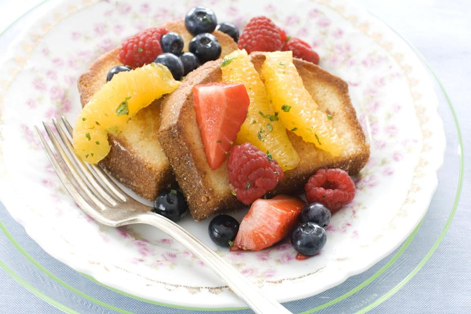 In this image taken on March 11, 2013, pan-seared pound cake with minty fruit salad is shown served on a plate in Concord, N.H. (AP Photo/Matthew Mead)