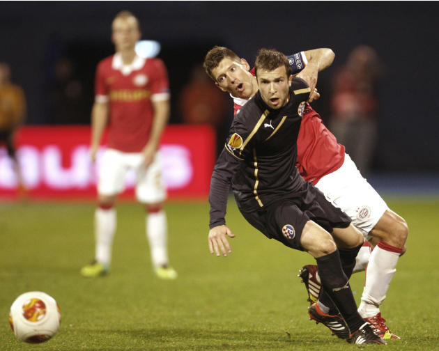Dinamo's Domagoj Antolic, front, is challenged by PSV's Stijn Schaars during a Europa League group B soccer match between PSV Eindhoven and Dinamo Zagreb, in Zagreb, Croatia, Thursday, Oct. 24, 2013