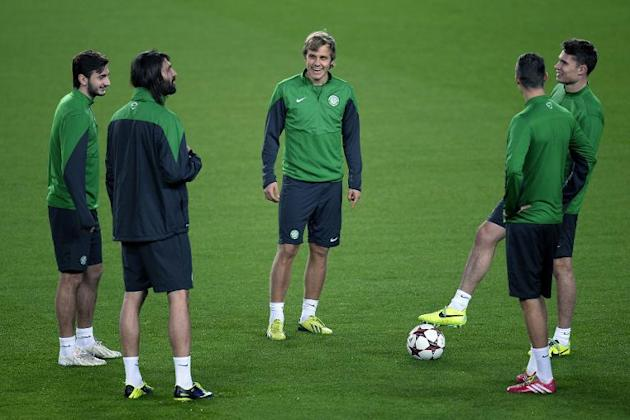 (From L) Celtic's Bahrudin Atajic, Georgios Samaras and Teemu Pukki chat with teammates during a training session at the Camp Nou stadium in Barcelona, on December 10, 2013