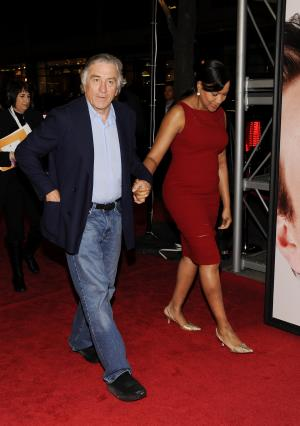 """Actor Robert De Niro and wife Grace Hightower attend the Tribeca Film Festival opening night premiere of """"The Five-Year Engagement"""" at the Ziegfeld Theatre on Wednesday, April 18, 2012 in New York. (AP Photo/Evan Agostini)"""