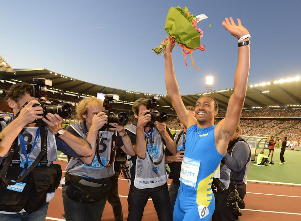 US athlete Aries Merritt reacts after winning the 110 meters hurdles and breaking a new world record, at the Diamond League Memorial Van Damme athletics event at Brussels' King Baudouin Stadium, Friday, Sept. 7, 2012. (AP Photo/Geert Vanden Wijngaert)