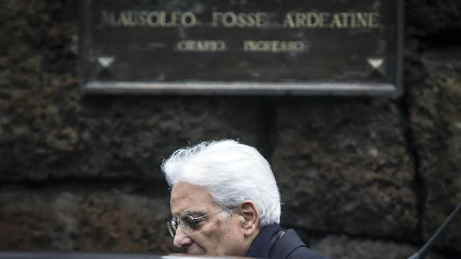 """New Italian President Sergio Mattarella leaves after a visit to the Fosse Ardeatine (Ardeatine Caves) in Rome, Saturday, Jan. 31, 2015, where 335 Italians were slaughtered by occupying Nazis on March 24, 1944. Mattarella applied a European-wide vision to his largely ceremonial post when he made a surprise, private visit to the Ardeatine Caves.  After pausing in reflection there, Mattarella hailed the wartime alliance """"between nations and peoples that knew how to defeat Nazi, racial, anti-Semitic and totalitarian hate"""" and called for more of the same solidarity now. (AP Photo/Angelo Carconi, Ansa) ITALY OUT"""