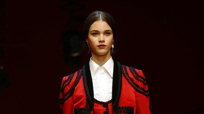 A model presents a creation from the Dolce & Gabbana Spring/Summer 2015 collection during Milan Fashion week
