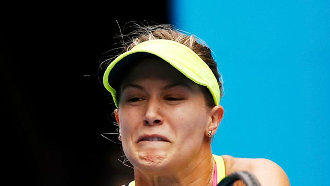 Bouchard of Canada hits a return to Sharapova of Russia during their women's singles quarter-final match at the Australian Open 2015 tennis tournament in Melbourne