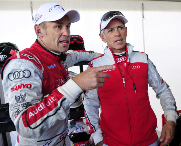 Audi Sport drivers Tom Kristensen, left, of Denmark, and Rinaldo Capello, of Italy, talk in the pits during warmup for the American Le Mans Series' Petit Le Mans auto race at Road Atlanta, Saturday, O