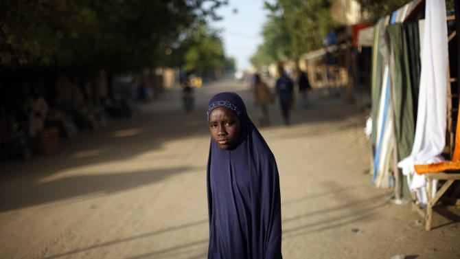 A Malian girl stands in the street in Gao, northern Mali, Tuesday Feb. 19, 2013. A French soldier has been confirmed dead during a military operation in northern Mali, French President Francois Hollande said on Tuesday(AP Photo/Jerome Delay)