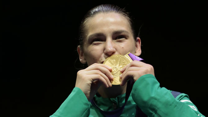 Gold medalist, Katie Taylor from Ireland,  participates in the a medals ceremony for women's lightweight 60-kg boxing at the 2012 Summer Olympics, Thursday, Aug. 9, 2012, in London.  (AP Photo/Ivan Sekretarev)