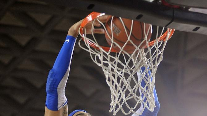 Kentucky forward Willie Cauley-Stein (15) dunks the ball during the first half of an NCAA college basketball game against Georgia in Athens, Ga., Thursday, March 7, 2013. (AP Photo/The Athens Banner-Herald, AJ Reynolds)  MAGAZINES OUT; MANDATORY CREDIT; TV OUT
