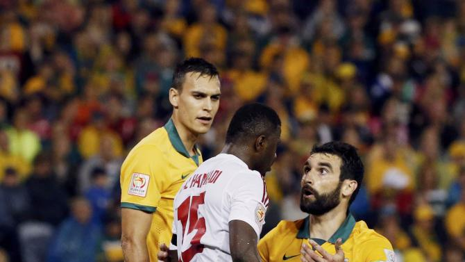 Australia's Mile Jedinak argues with UAE's Ismail Al Hammadi after a challenge during their Asian Cup semi-final soccer match at the Newcastle Stadium in Newcastle