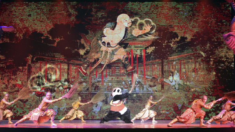 """FILE - In this Jan. 3, 2014, file photo, actors perform during a preview of """"PANDA!"""" in the Palazzo Theater at the Palazzo hotel-casino in Las Vegas. """"PANDA!"""" is the first Chinese-produced show to take up residency on the famous tourist corridor. Directed by An Zhou, the man behind the 2008 Beijing Olympics opening and closing ceremonies, """"PANDA!"""" opened to mixed critical reviews in December and recently added dates through July. It follows two Chinese-produced resident shows in Branson, Mo., and a steady flow of touring Chinese arts troupes. (AP Photo/Las Vegas Review-Journal, Jerry Henkel, File)"""