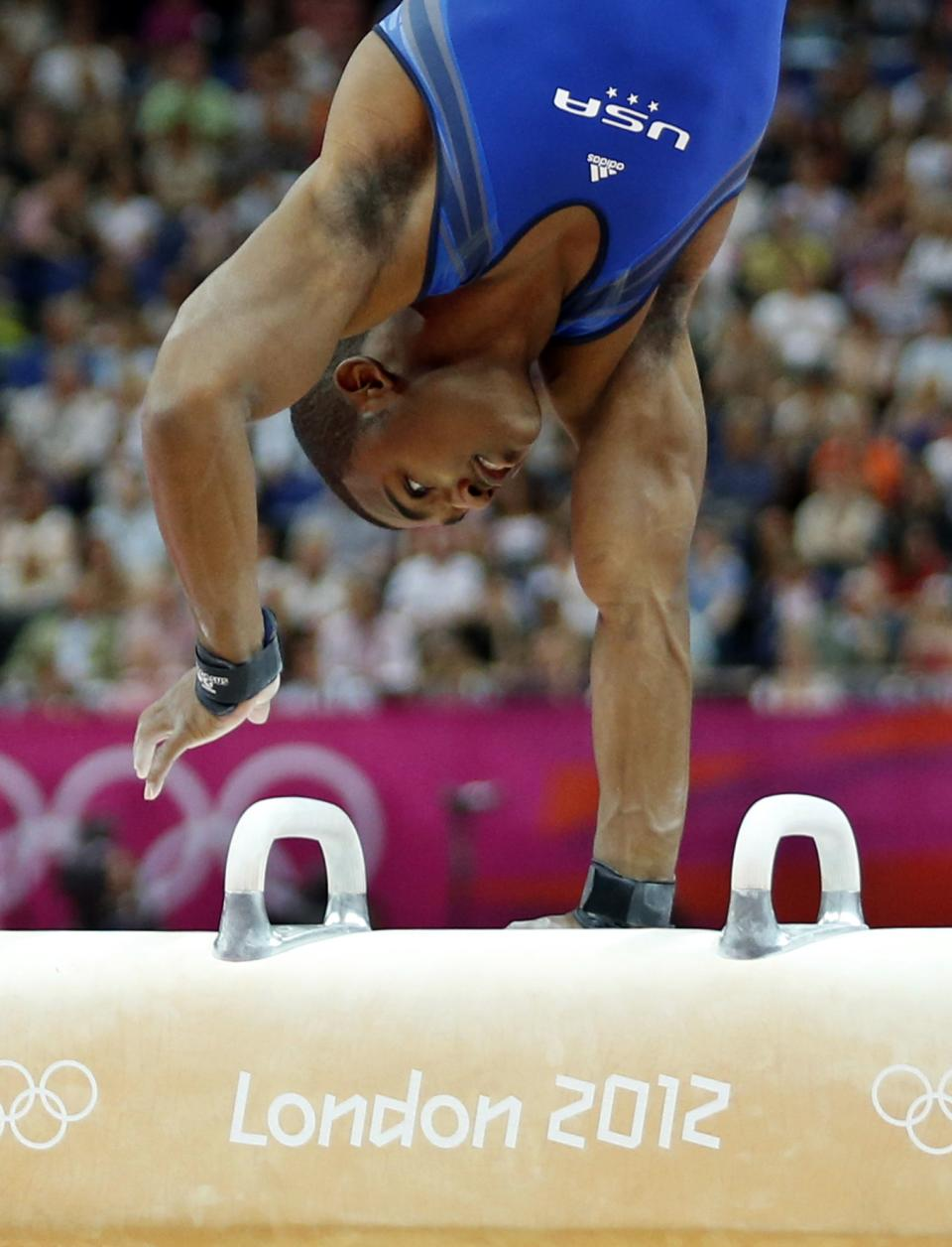 U.S. gymnast John Orozco performs on the pommel horse during the Artistic Gymnastics men's qualification at the 2012 Summer Olympics, Saturday, July 28, 2012, in London. (AP Photo/Matt Dunham)