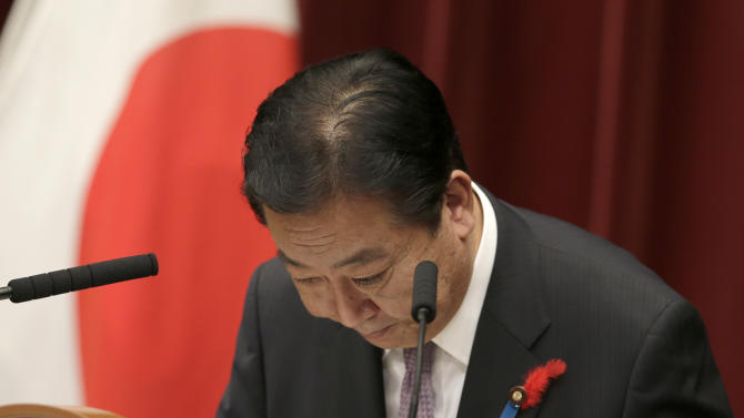 Japan's Prime Minister Yoshihiko Noda bows after a press conference to announce his cabinet reshuffle at the prime minister's official residence in Tokyo, Monday, Oct. 1, 2012. Noda has reshuffled his Cabinet for the third time this year in hopes of boosting flagging public support for his government.  (AP Photo/Shizuo Kambayashi)