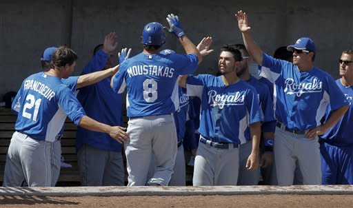Royals outslug Brewers 9-7