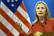 US Secretary of State Hillary Clinton speaks during a press conference with Vietnamese Foreign Minister Pham Binh Minh at the Government Guest House in Hanoi. Clinton will Wednesday become the first US secretary of state to visit communist-run Laos in 57 years on a brief trip focusing on the legacy of the Vietnam War and a controversial dam project