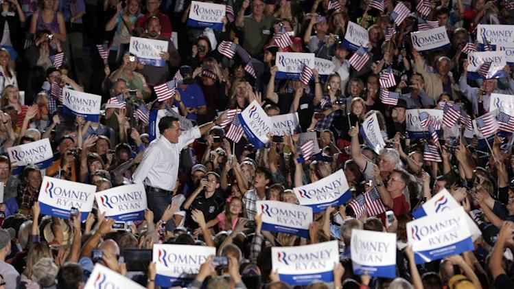 Republican presidential candidate and former Massachusetts Gov. Mitt Romney campaigns at D'Evelyn High School in Denver, Sunday, Sept. 23, 2012.(AP Photo/Joe Mahoney)