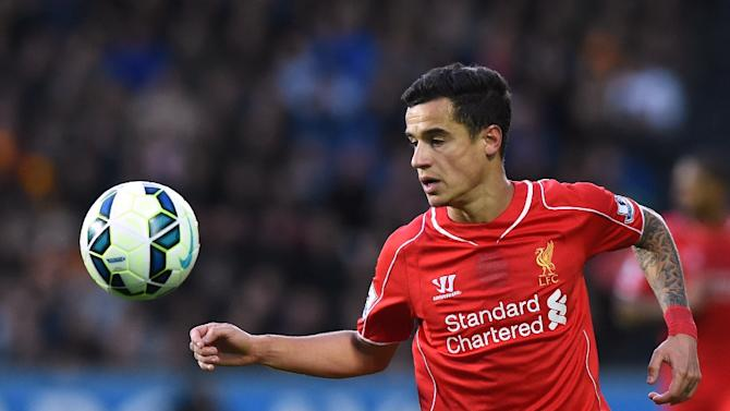 Liverpool's midfielder Philippe Coutinho controls the ball during the English Premier League football match on April 28, 2015